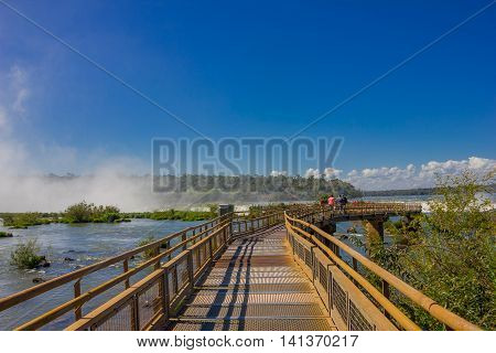 IGUAZU, ARGENTINA - MAY 14, 2016: bridge thats goes to the devils throath located in the argentinian border of the falls.