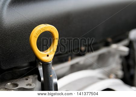 The oil dipstick of a car engine