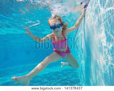 little girl swim in the pool
