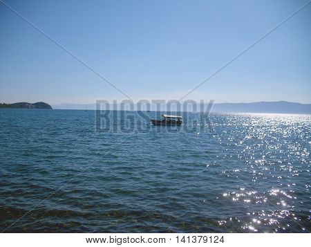 Boat on Lake Ohrid in Macedonia with hills in background