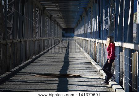 Sexy women with blonde hair on a bridge