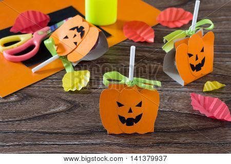 The Child Create A Greeting Packaging For Candy On Halloween Pumpkin Paper. Packing Gift Paper Pumpk