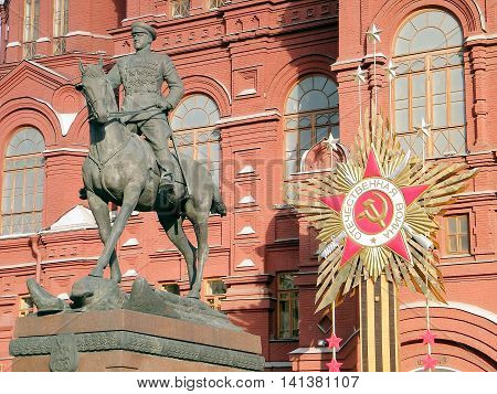 Monument to Marshal Zhukov at sunset on the background of the Historical Museum in Moscow Russia