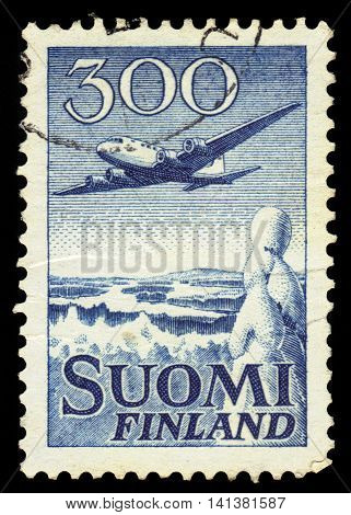 FINLAND - CIRCA 1950: a stamp printed in Finland shows aircraft ‭Douglas DC-6 over winter landscape, circa 1950
