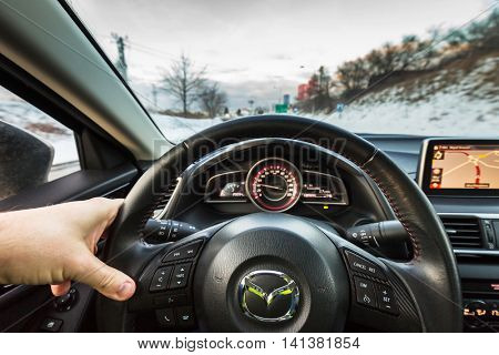 POLAND - JANUARY 20, 2016: Interior of new Mazda 3 captured with low depth of field technique. Mazda 3 is a popular compact car manufactured in Japan by the Mazda Motor Corporation.