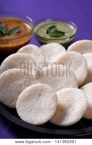 Idli With Sambar And Coconut Chutney On Violet Background, Indian Dish : South Indian Favourite Food