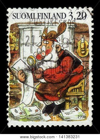 FINLAND - CIRCA 1996: a stamp printed in Finland shows Santa Klaus reads letters of children, Finland, circa 1996