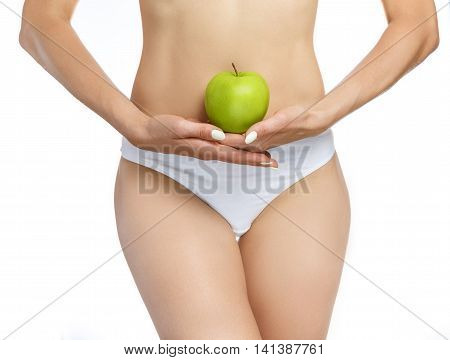 A woman's body, in the hands holding an apple on a white background