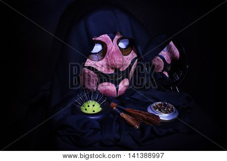 terrible mask objects of black magic and witchcraft on a black background