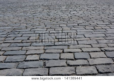 background of gray rectangular stone blocks paving stones view from below