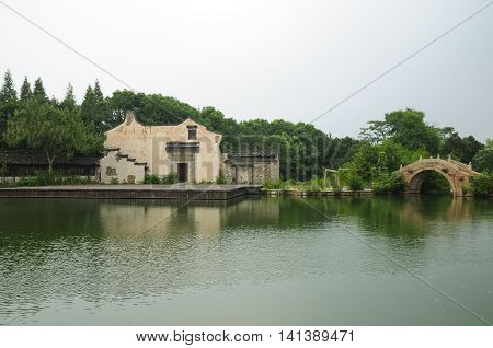 The water theater stage and arched bridge within Tongxiang's West Wuzhen Scenic Area in Zhejiang province China.