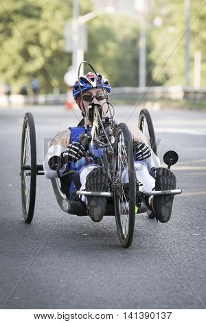 NEW YORK JUL 24 2016: ParaTriathlete competing in the NYC Triathlon Race, biking 40 kilometers mainly on the Henry Hudson Parkway in New York on the only International Distance triathlon in Manhattan.