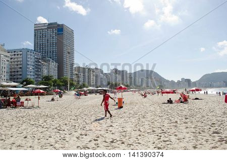 RIO DE JANEIRO, BRAZIL- JULY 31, 2012: A view of Copacabana beach in the morning with hotel buildings and people in Rio de Janeiro, Brazil