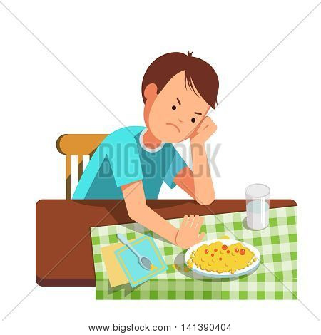 A little boy refusing food kid does not want to eat. Kid sits at the table and does not want to eating