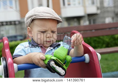 Child Playing With Toy Excavator