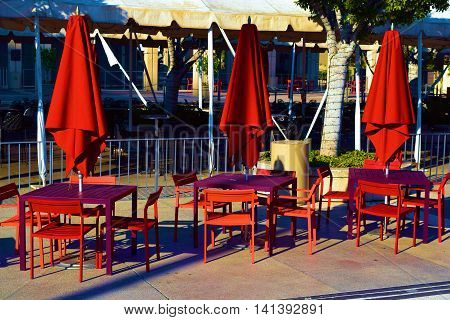 Modern style outdoor furniture including tables and chairs taken in a courtyard garden