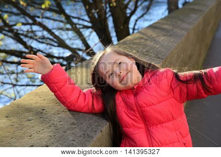 Little girl have fun on the Paris street