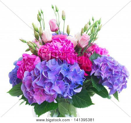 Bright pink peony, eustoma and blue hortensia flowers bouquet close up isolated on white background