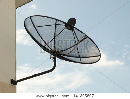 Black Satellite Dish Mounted On The Wall Outside The Home