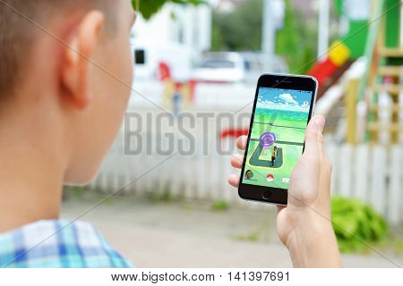 Kiev Ukraine - August 02 2016 : Apple iPhone 6 in boy's hand showing its screen with Pokemon Go application.