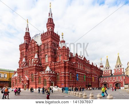 MOSCOW - SEPTEMBER 22, 2015: Tourists walking in front of State Historical Museum of Russia. This museum is located between Red and Manege Square.