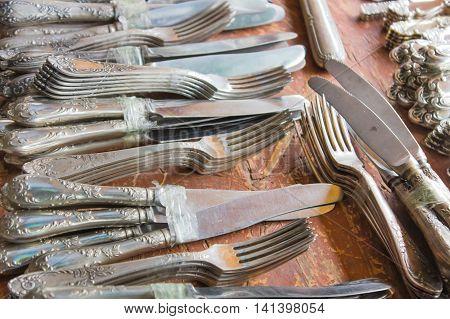 Many silver cutlery at a flea market