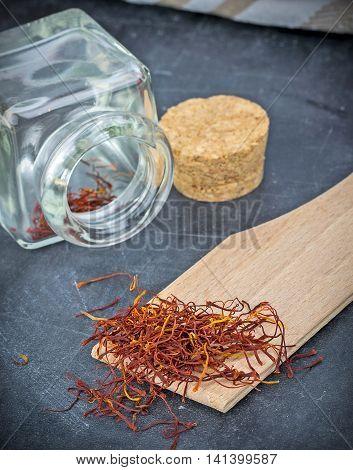 Saffron spice on a dark slate background