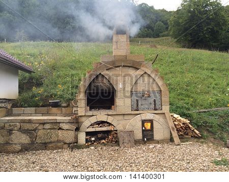 Romania, August 20, 2015, Gura-Teghii,Buzau County, Moldova,  Bed&breakfast in the mountains-exterior bread oven