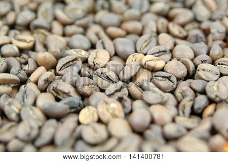 Coffee beans. Pile of coffee beans. Roasted coffee beans.