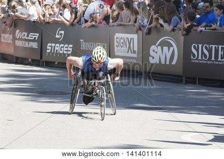 NEW YORK JUL 24 2016: ParaTriathlete from CAF, Challenged Athletes Foundation, nears the finish line in Central Park in the NYC Triathlon Race, the only International Distance triathlon in the city.