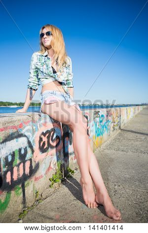Young Barefoot Blond Woman