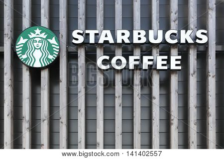 Villefranche, France - July 14, 2016: Starbucks logo on a wall. Starbucks is an American coffee company and coffeehouse chain