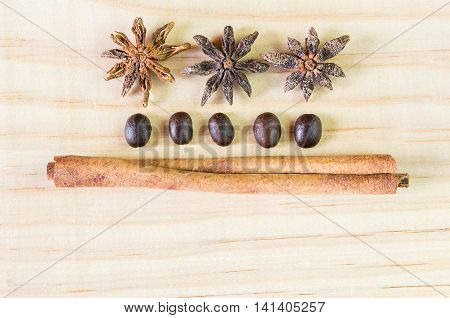 Spice and coffee beans on wooden table. top view with copy space