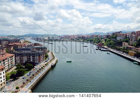 GETXO, near BILBAO. July 27th 2016. A stunning view of Getxo back towards Bilbao greets tourists brave enough to take the lift to the top walkway of its transporter bridge.