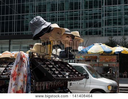 New York NY USA -- Aug 3 2016 Mannequins wearing hats on display by a street vendor. Editorial Use Only