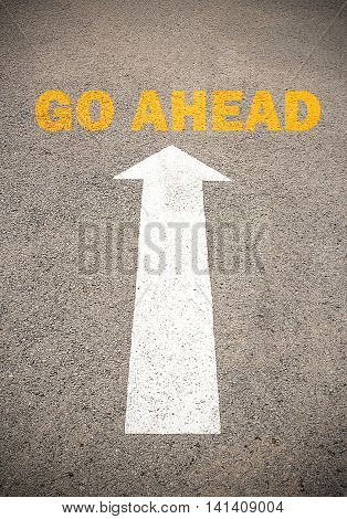Text for GO AHEAD. Concept on the road surface marking with arrow for any design