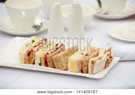 A plate of sandwiches on a white plate