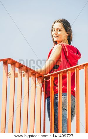 Urban Girl On Bridge In City.