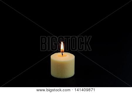 candle flame fire of white candle on black background