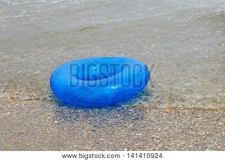 lifebuoy floating on water in the beach