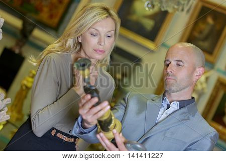 auction concept woman customer and male auctioneer