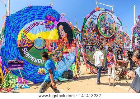 Sumpango Guatemala - November 1 2015: Visitors & ice cream seller at giant kite festival honoring spirits of the dead on All Saints' Day.