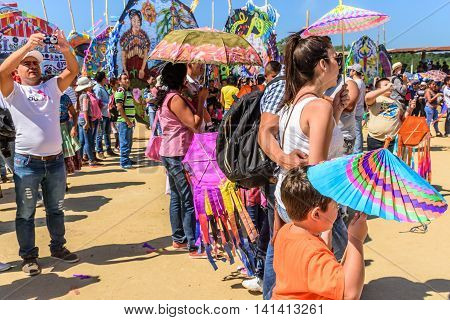 Sumpango Guatemala - November 1 2015: Visitors at giant kite festival honoring spirits of the dead on All Saints' Day.