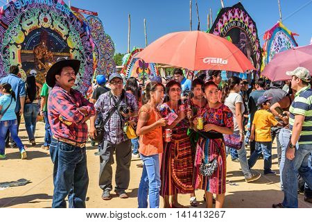 Sumpango Guatemala - November 1 2015: Visitors at giant kite festival honoring spirits of the dead on All Saints' Day.