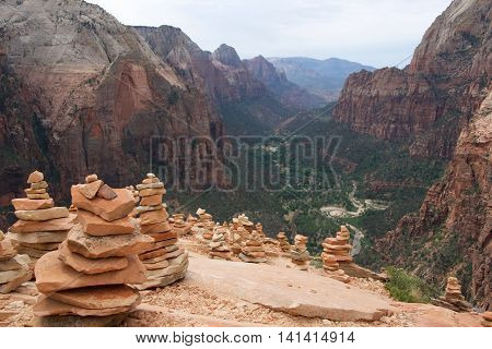 kairns sitting on top of angels landing in Zion National Park