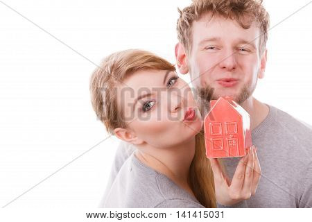Couple Share Kisses With House Symbol.