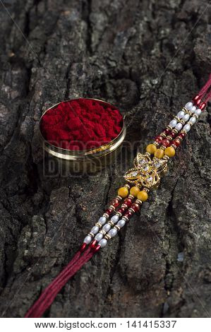 A Rakhi with kumkum holder. An Indian festive background.