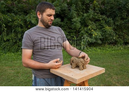 Artist Modeled A Piece Of Clay