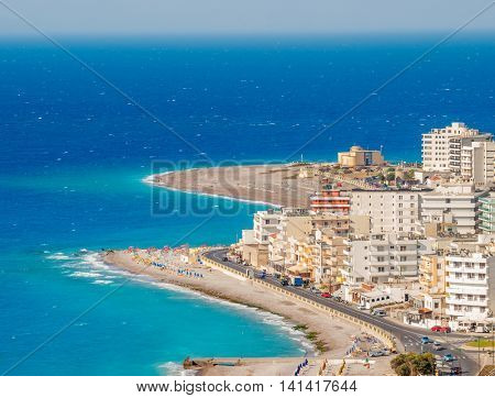 Rhodes town tourist district with sand beaches and turquoise Aegean Sea in summer sunny day, Greece.