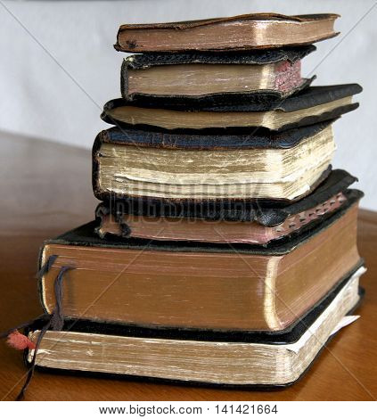 Stack of old books, bibles and prayer books.